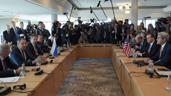 Russian Foreign Minister Sergei Lavrov (second left) and US Secretary of State John Kerry (right) participating in a bilateral meeting on the eve of an International Syria Support Group (ISSG) session in Munich. (File) - Sputnik International