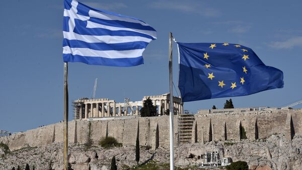 The Greek and EU flags flutter in front of the ancient Acropolis hill in Athens - Sputnik International