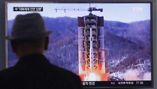 A man watches a TV news program showing a file footage of North Korea's rocket launch at Seoul Railway Station in Seoul, South Korea, Thursday, April 28, 2016. - Sputnik International