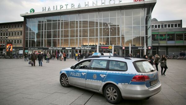 A police car passes the central railway station in Cologne, Germany. (File) - Sputnik International
