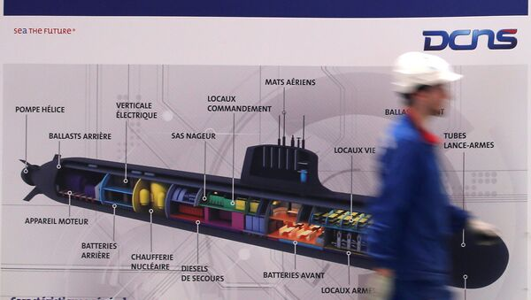 An employee walks past a poster showing a Barracuda submarine at the industrial site of the naval defence company and shipbuilder DCNS in La Montagne near Nantes, France, April 26, 2016 - Sputnik International