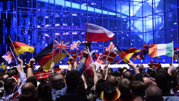 Supporters wave flags ahead of the Eurovision Song Contest 2014 Grand Final in Copenhagen, Denmark, on May 10, 2014 - Sputnik International