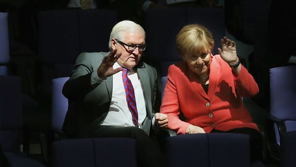 German Chancellor Angela Merkel, right, and Foreign Minister Frank-Walter Steinmeier wave as they attend a meeting of the German Federal Parliament, Bundestag, at the Reichstag building in Berlin, Germany, Thursday, Sept. 24, 2015 - Sputnik International