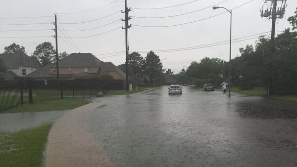 In this April 18, 2016 a view of flooded streets in the Kelliwood Park neighborhood of Katy, Texas. - Sputnik International