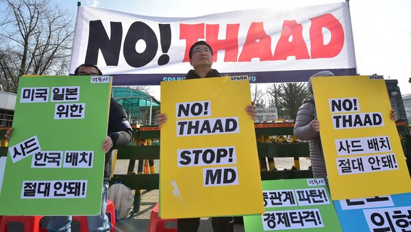 Anti-war activists hold placards during a rally against talks on deployment of the US-built outside South Korea's Defence Ministry in Seoul on March 4, 2016 - Sputnik International