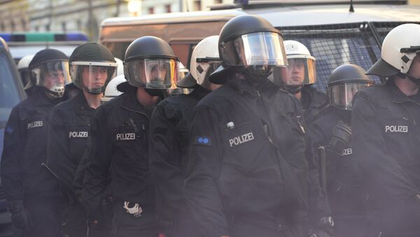 Police patrol at the traditional 'Revolutionary' May Day demonstration in Berlin, on May 1, 2016. Thousands of leftists, trade unionists and workers took to the streets of the capital on the occasion of International labour day. - Sputnik International