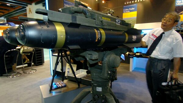 A man looks at the latest US-made Hellfire II missiles during at the defense industry exhibition in Taipei, 11 August 2005 - Sputnik International