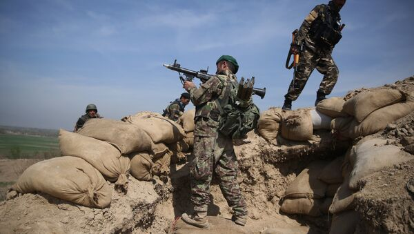 An Afghan National Army soldier, center, takes his position, following weeks of heavy clashes to recapture the area from Taliban militants in Dand-e Ghouri district in Baghlan province, north of Kabul, Afghanistan (File) - Sputnik International