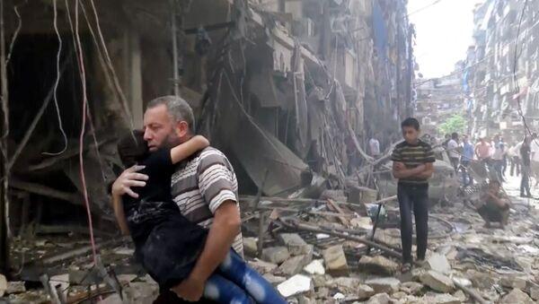 Man carries a child after airstrikes hit Aleppo, Syria, Thursday, April 28, 2016 - Sputnik International