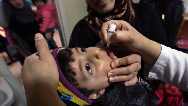 Syrian refugee Mohammed Sammor, 3, receives vaccination against polio (File) - Sputnik International