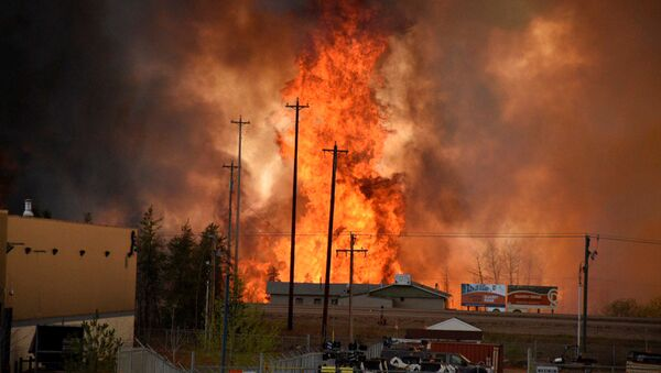 Flames rise in Industrial area south Fort McMurray, Alberta Canada May 3, 2016. - Sputnik International