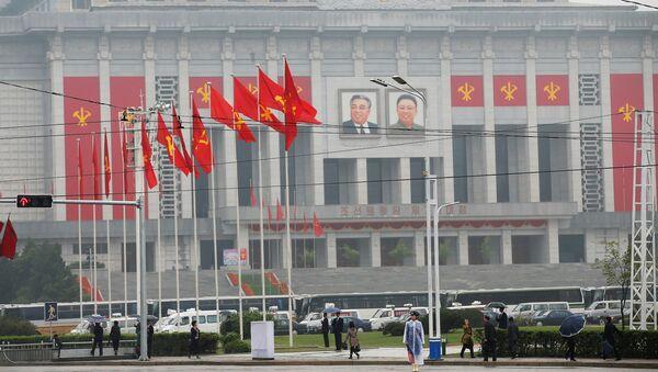 People walk near the venue of a ruling party congress in Pyongyang, North Korea May 6, 2016. - Sputnik International