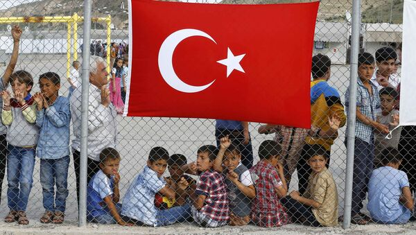 An elderly refugee man stands with children as they wait for the arrival of German Chancellor Angela Merkel, Turkish Prime Minister Ahmet Davutoglu, EU Council President Donald Tusk and European Commission Vice-President Frans Timmermans (all not pictured) at Nizip refugee camp near Gaziantep, Turkey, April 23, 2016.s - Sputnik International