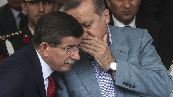 Turkey President Recep Tayyip Erdogan (R) speaks with Turkish prime minister Ahmet Davutoglu (L) (file) - Sputnik International