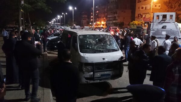 Egyptian police and civilians gather around a bullet ridden microbus in the south Cairo neighborhood of Helwan, Sunday, May 8, 2016 - Sputnik International