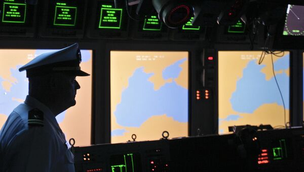 A US Navy officer, name not available, looks on at the weapons control deck of the USS Monterey in the Black Sea port of Constanta, Romania, Tuesday, June 7, 2011 - Sputnik International