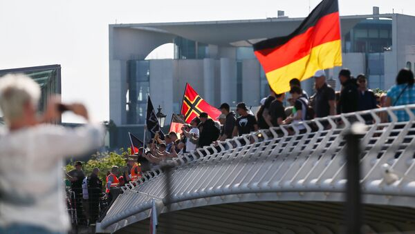 Right-wing protestors demonstrate against refugees, Islam and German Chancellor Angela Merkel in front of the chancellery in Berlin, Germany, May 7, 2016 - Sputnik International