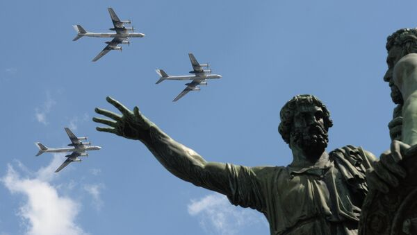 The Tu-95 bombers seen flying over Moscow's Red Square during the rehearsal of the May 9 Victory Day Parade - Sputnik International