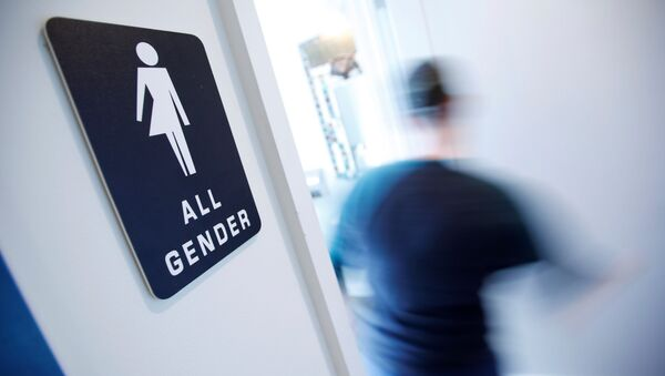 A bathroom sign welcomes both genders at the Cacao Cinnamon coffee shop in Durham, North Carolina May 3, 2016 - Sputnik International