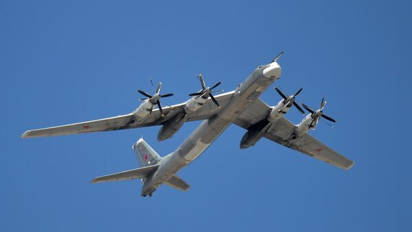 The Tu-95MS is seen flying during the rehearsal of the May 9 Victory Day Parade in Moscow - Sputnik International