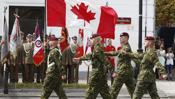 A military unit from Canada marches during a military parade marking Polish Armed Forces Day, in Warsaw, Poland (File) - Sputnik International