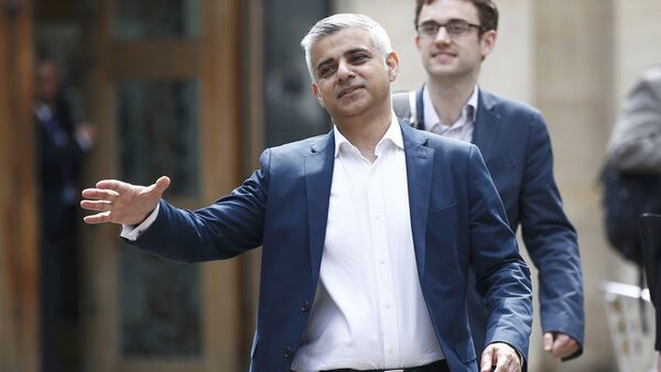 London's Mayor elect, Sadiq Khan, goes to shake hands with a passer-by as he leaves Southwark Cathedral in London, Britain, May 7, 2016. - Sputnik International
