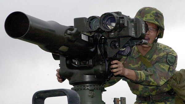 A military soldier operates a TOW anti-tank missile launcher. File photo - Sputnik International