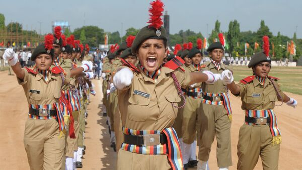 Female National Cadet Corps Commander N.M.R. Sanjana leads a march past during a full dress rehearsal for Independence Day celebrations in Secunderabad, the twin city of Hyderabad, on August 13, 2012 - Sputnik International