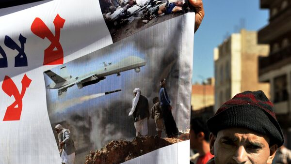 A Yemeni hold up a banner during a protest against US drone attacks on Yemen close to the home of Yemeni President Abdrabuh Mansur Hadi, in the capital Sanaa, on January 28, 2013. - Sputnik International