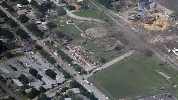 This April 18, 2013, file aerial photo shows the remains of a nursing home, left, apartment complex, center, and a fertilizer plant, right, destroyed by an explosion in West, Texas - Sputnik International