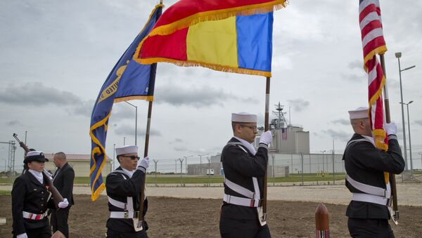 US Navy flag bearers, backdropped by the radar building of a missile defense base, walk in Deveselu, during an opening ceremony attended by U.S., NATO and Romanian officials at a base, originally established by the Soviet Union, in Deveselu, Southern Romania, Thursday, May 12, 2016. - Sputnik International