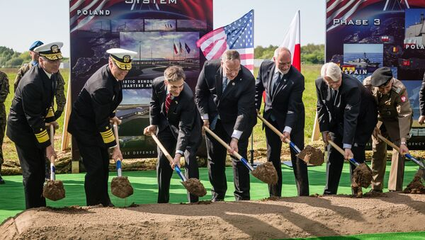 US Deputy Secretary of Defence Bob Work (C), Polish Minister of Defence Antoni Macierewicz (3rdR), Polish Foreign Affairs Minister Witold Waszczykowski (2ndR) and other officials take part in ground breaking ceremony of the northern section of defence anti-missile shield in Redzikowo military base in northern Poland - Sputnik International