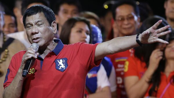 Philippine presidential race front-runner Davao city mayor Rodrigo Duterte gestures during his final campaign rally in Manila, Philippines on Saturday, May 7, 2016. - Sputnik International