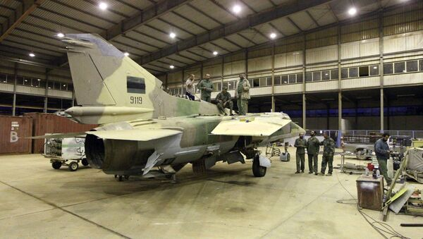 Engineers from the Libyan air force repair a MIG-23bn fighter jet at a military air base in the eastern coastal city of Benghazi on May 2, 2016 - Sputnik International