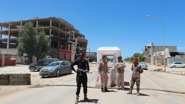 Members for the Libyan Armed Forces stand at the checkpoint in Benghazi, Libya May 16, 2016 - Sputnik International