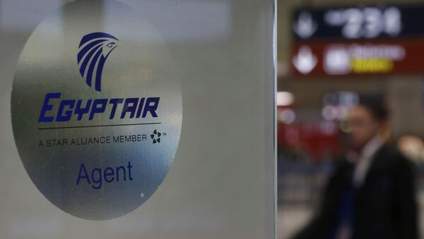 A man passes the Egyptair desk at Charles de Gaulle airport, after an Egyptair flight disappeared from radar during its flight from Paris to Cairo, in Paris, France, May 19, 2016 - Sputnik International