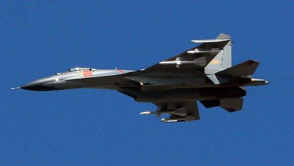 The latest Chinese Jian-series fighter jet executes a fly-by over Beijing on September 12, 2009 during a rehearsal for National Day - Sputnik International