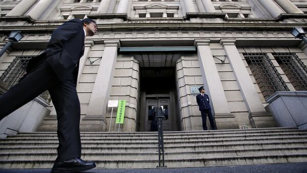 In this Nov. 19, 2014 file photo, a man walks by the Bank of Japan headquarters in Tokyo - Sputnik International