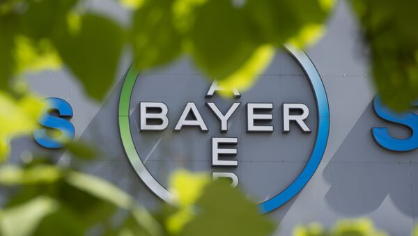 This file photo taken on July 24, 2013 shows a logo of German pharmaceuticals and chemicals giant Bayer on an overpass at its Berlin headquarters - Sputnik International