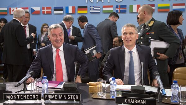 NATO Secretary General Jens Stoltenberg, right, and Montenegro's Prime Minister Milo Dukanovic, left, take their seats during a meeting of the North Atlantic Council and Montenegro at NATO headquarters in Brussels on Thursday, May 19, 2016 - Sputnik International