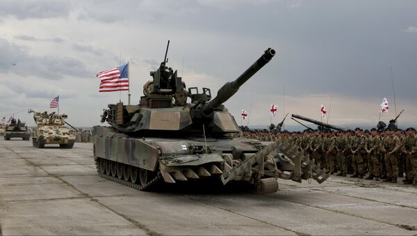 U.S servicemen drive their armored vehicles at the opening ceremony of U.S, British and Georgian troops joint military exercises at the Vaziani military base outside Tbilisi, Georgia, Wednesday, May 11, 2016. - Sputnik International