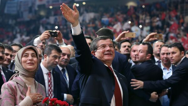 Head of the governing Justice and Development Party and Prime Minister Ahmet Davutoglu with his wife Sare Davutoglu, left, waves towards supporters during the party congress in Ankara, Turkey, Sunday, May 22, 2016. - Sputnik International