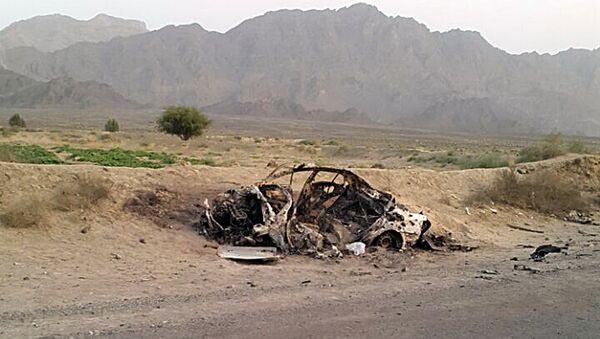 This photo taken by a freelance photographer Abdul Salam Khan using his smart phone on Sunday, May 22, 2016, purports to show the destroyed vehicle in which Mullah Mohammad Akhtar Mansour was traveling in the Ahmad Wal area in Baluchistan province of Pakistan, near Afghanistan's border. - Sputnik International