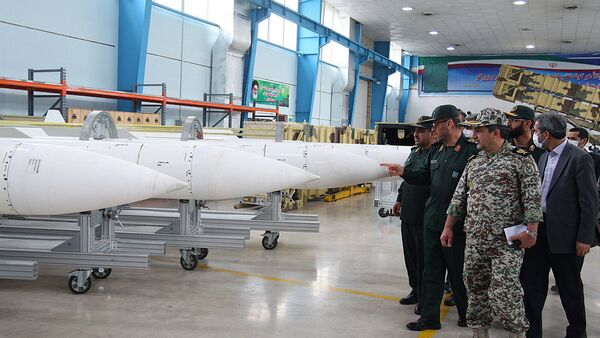 Iran's Defence Minister Hossein Dehqan (2nd L) pointing at an anti-missile system missiles of Sayyad-2 (Hunter 2), during the inauguration of it's production line in Tehran on November 9, 2013 - Sputnik International