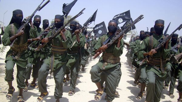 In this Thursday, Feb. 17, 2011 file photo, al-Shabab fighters march with their weapons during military exercises on the outskirts of Mogadishu, Somalia - Sputnik International