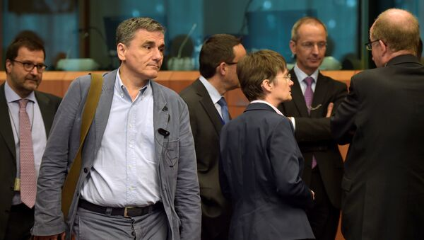 Greece's finance Minister Euclid Tsakalotos arrives at a Euro zone finance ministers meeting to discuss whether Greece has passed sufficient reforms to unblock new loans and how international lenders might grant Athens debt relief, in Brussels, Belgium May 24, 2016. - Sputnik International