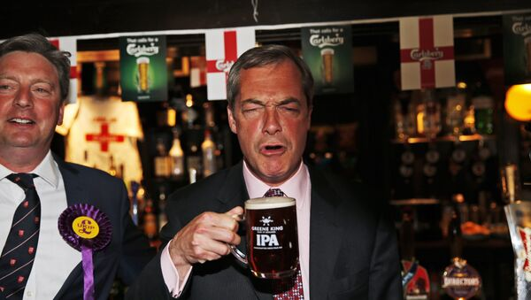 In this Friday, May 23, 2014 file photo, Nigel Farage, leader of Britain's United Kingdom Independence Party (UKIP) enjoys a pint of beer in South Benfleet, England.  - Sputnik International