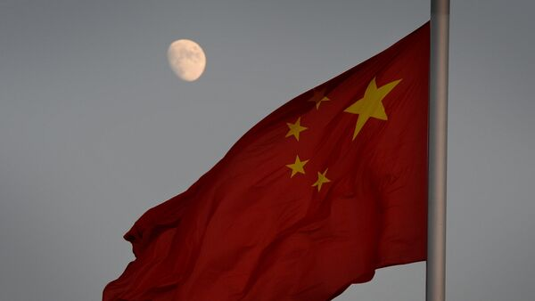 The Chinese flag is seen in front of a view of the moon at Tiananmen Square in Beijing on December 13, 2013 - Sputnik International