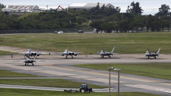 U.S. Air Force F-22 Raptors, right, and two F-15 Eagles prepare for take-off at Kadena Air Base on the southern island of Okinawa, in Japan (File) - Sputnik International