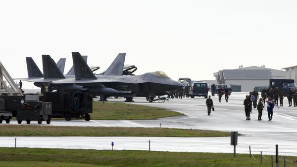 US Air Force's new stealth fighters F-22A Raptor (L) are lined up at the Kadena US Air Base, in Kadena town (File) - Sputnik International